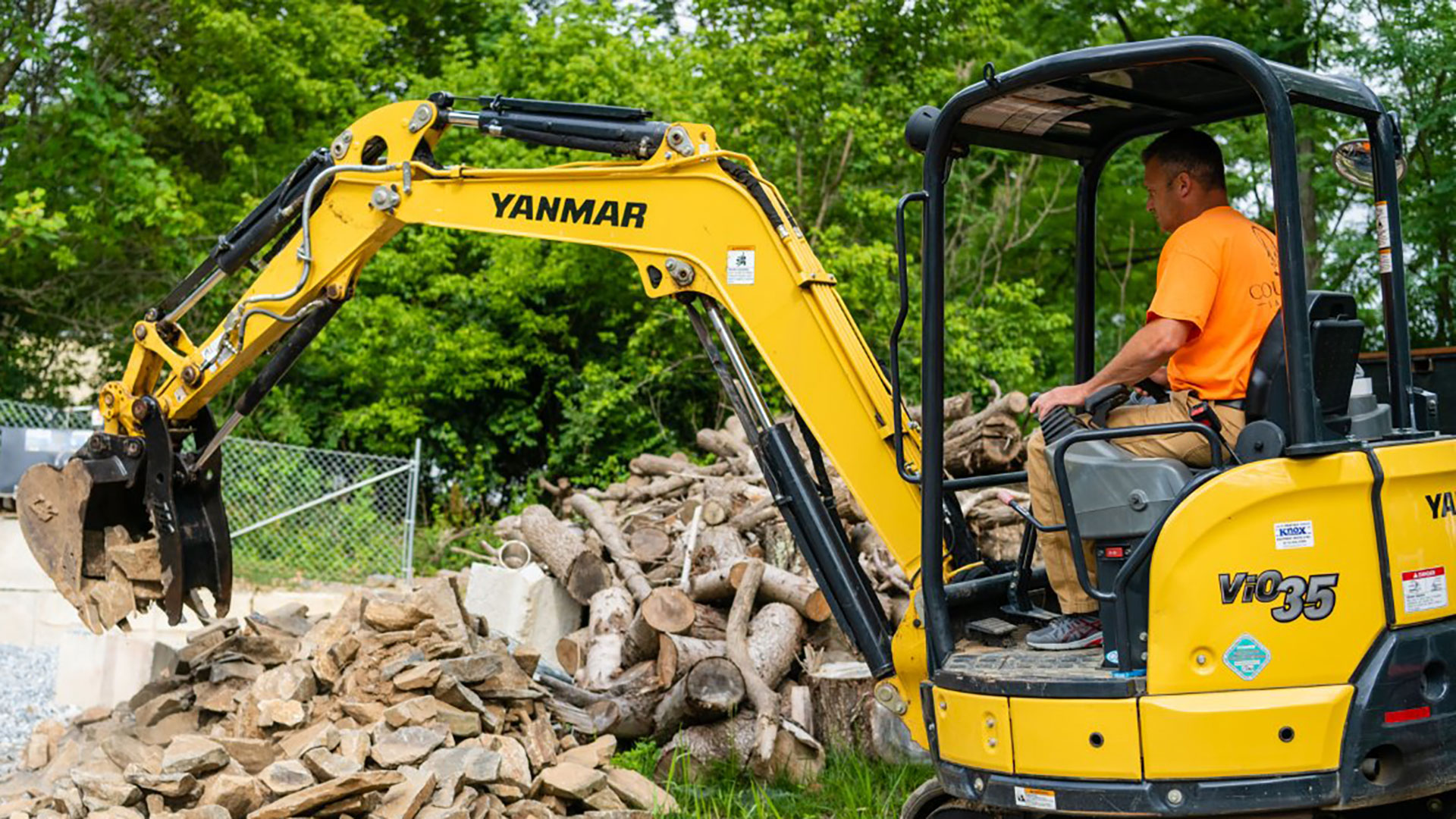 Our landscaper operating an excavator on a property in Downingtown, PA.
