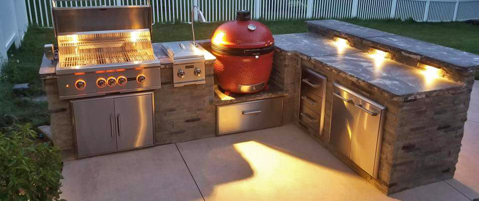 Custom outdoor kitchen with grill and countertops in West Chester, PA.