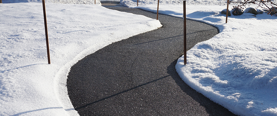 Snow removed from a path near a commercial lot in West Chester, PA.